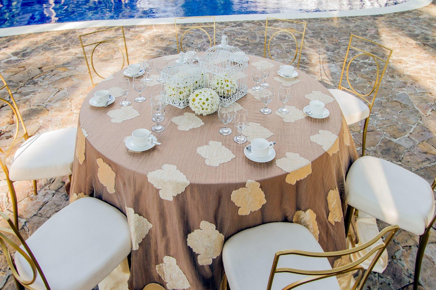 Patterned linens on banquet table set for wedding reception by p