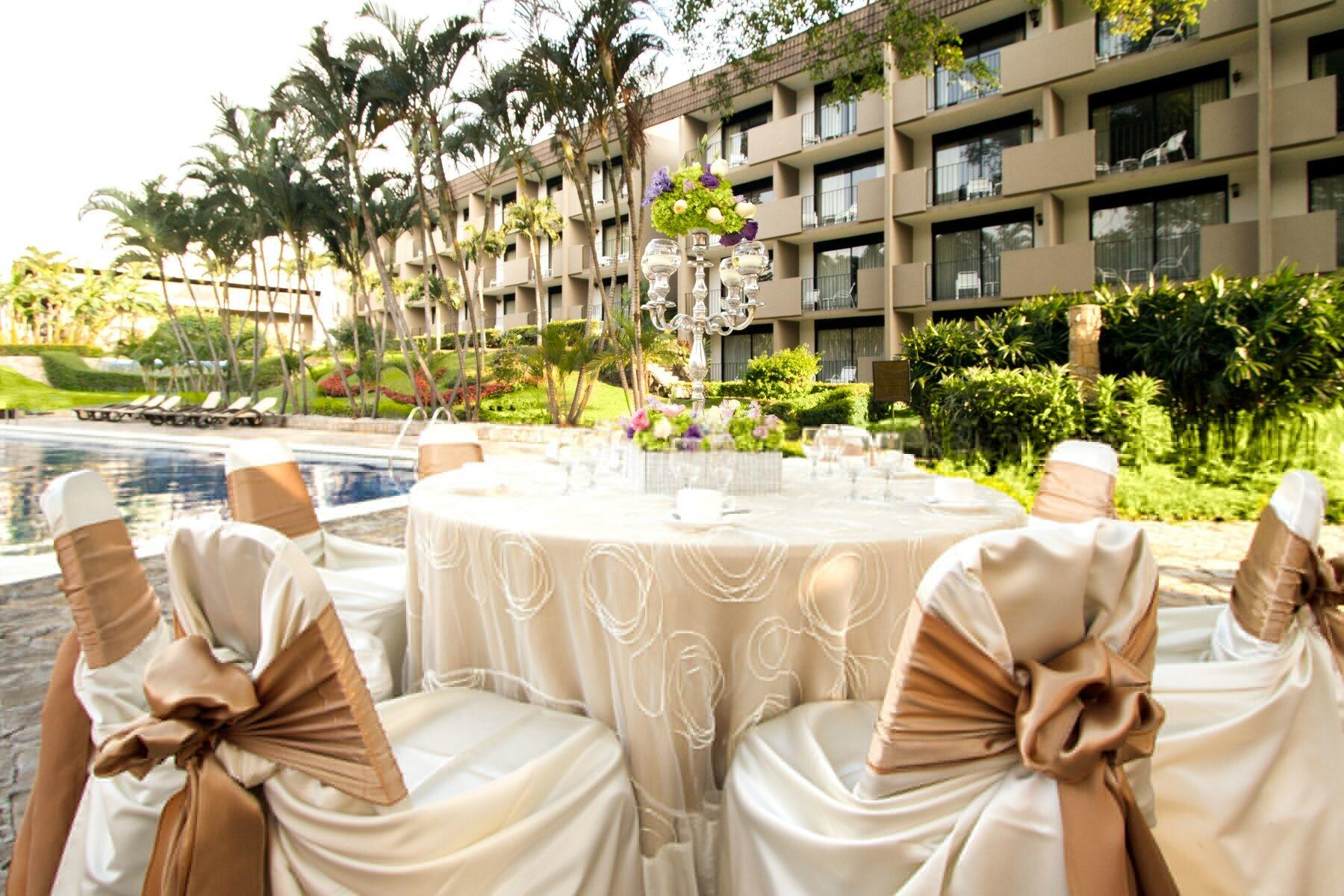 Banquet rounds with elegant linens set for outdoor wedding recep