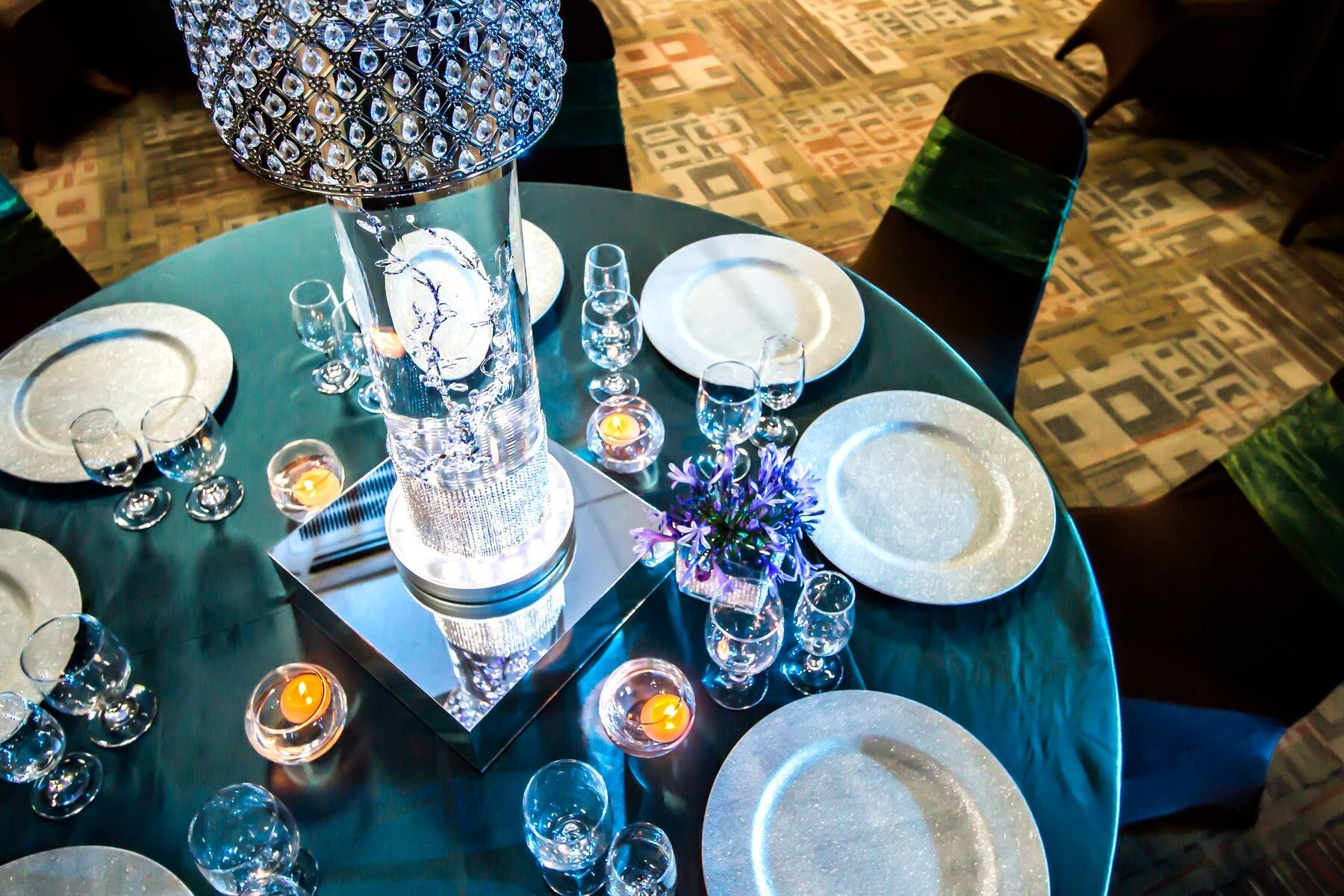 View of place settings and centerpieces on banquet table from ab