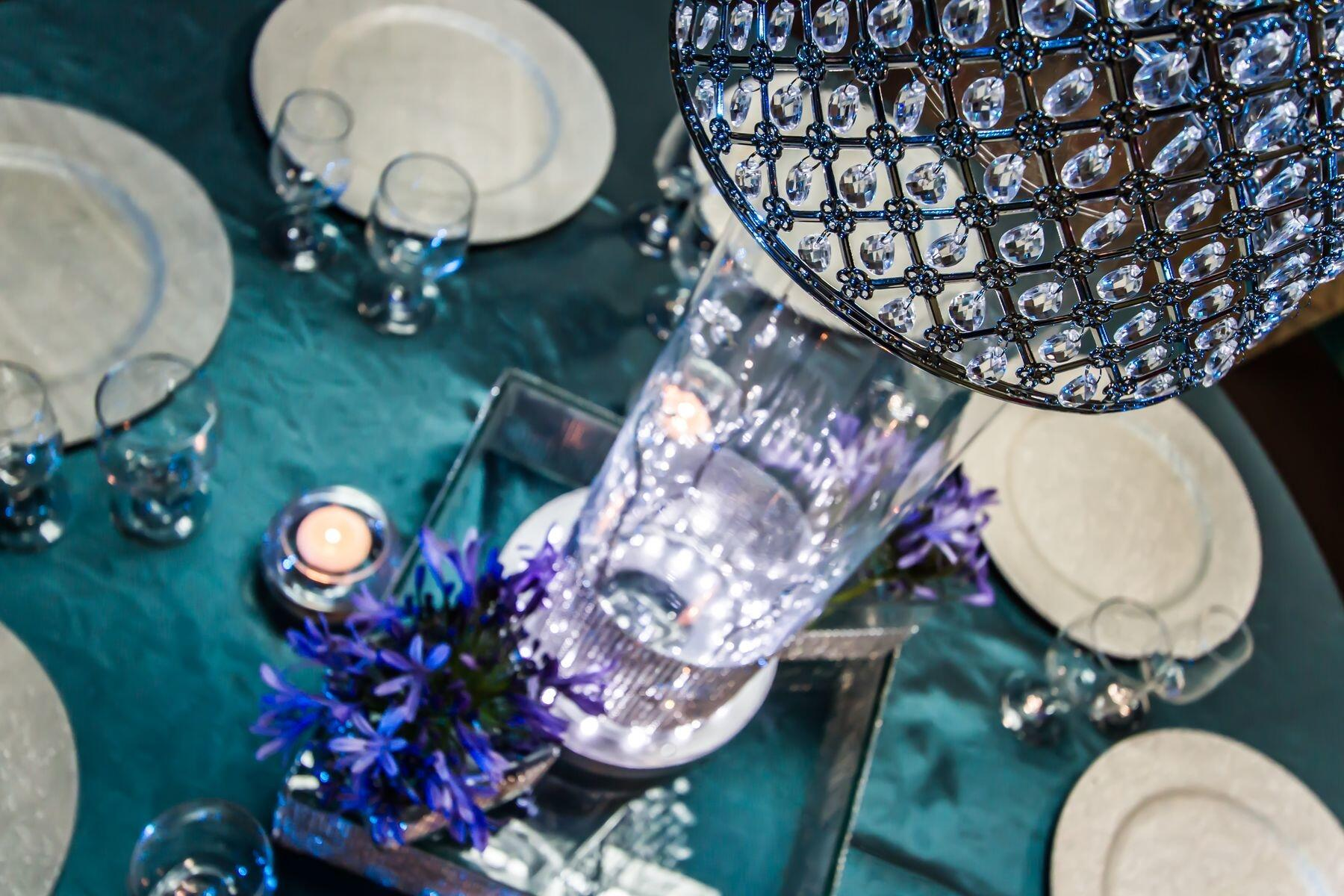 Crystal accented centerpiece set at banquet table