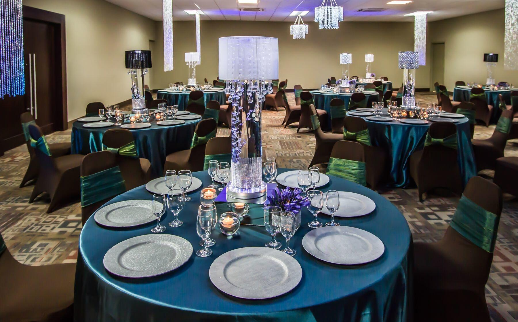 Banquet rounds set with place settings and centerpieces
