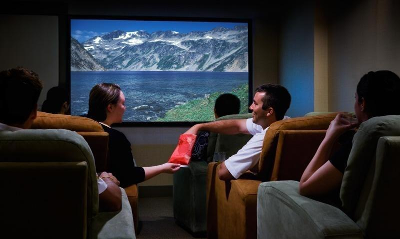 Guests watching movie in private theater