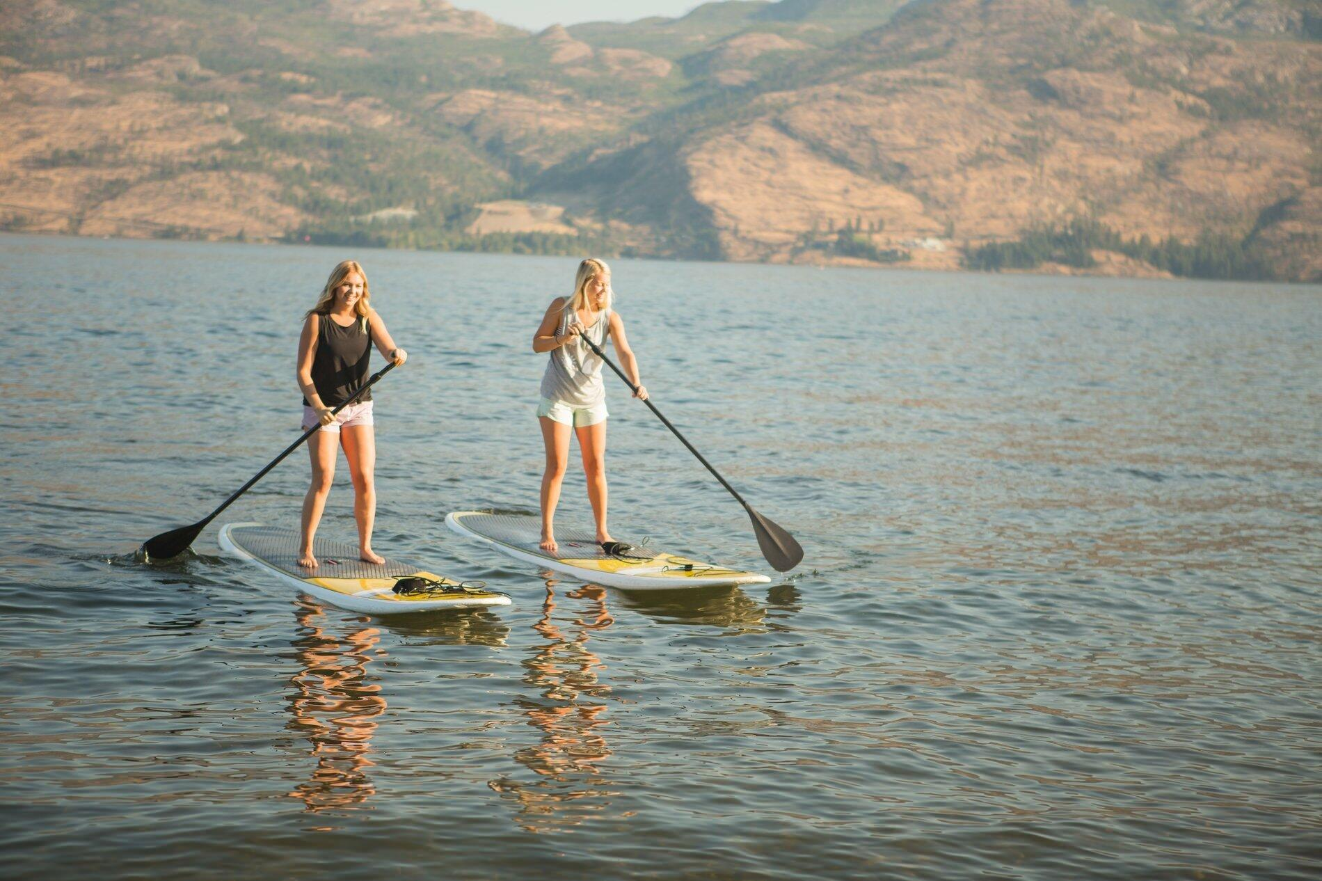 Duo on paddleboards on the lake