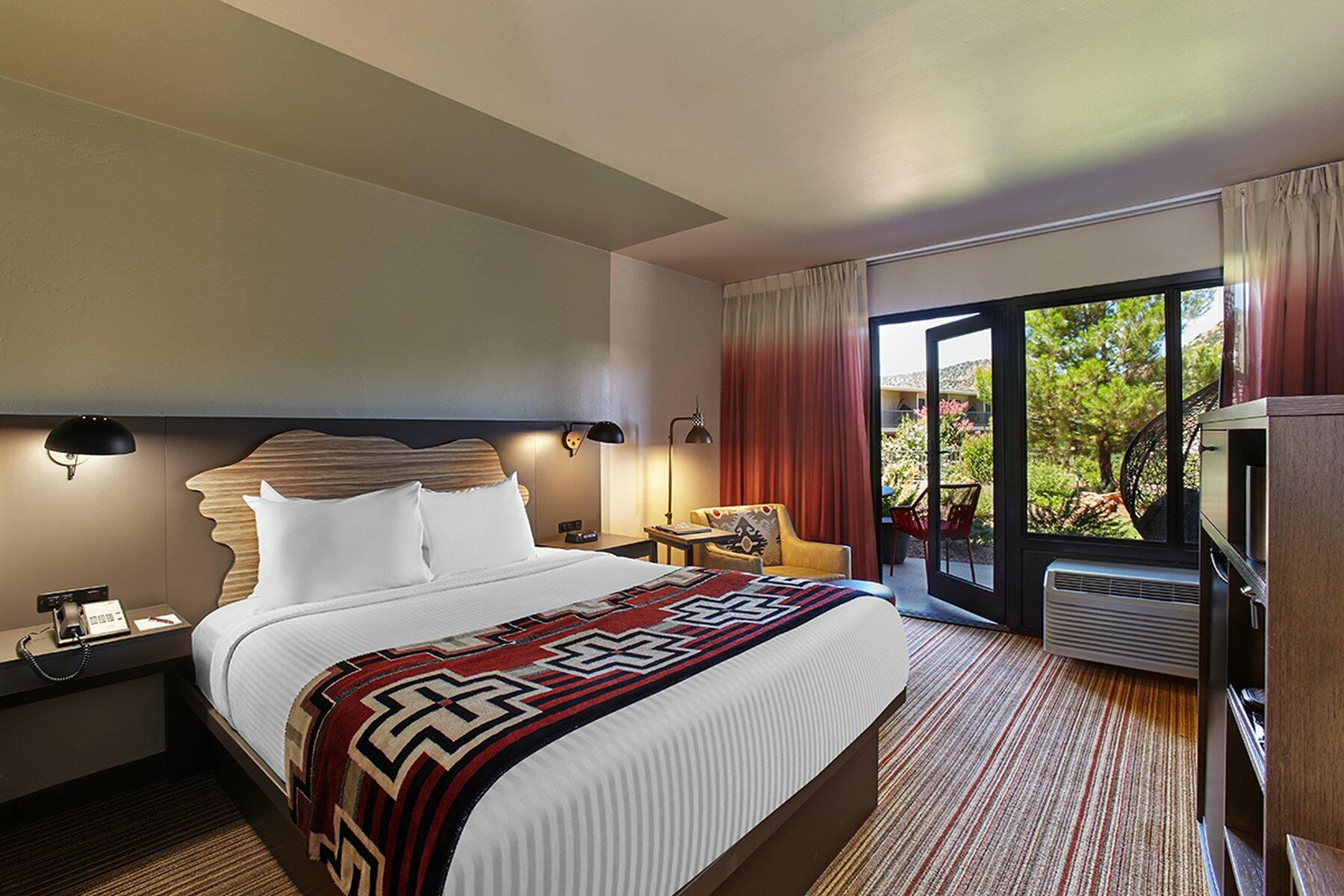 Courtyard suite hotel room, queen bed & view of Red Rocks.