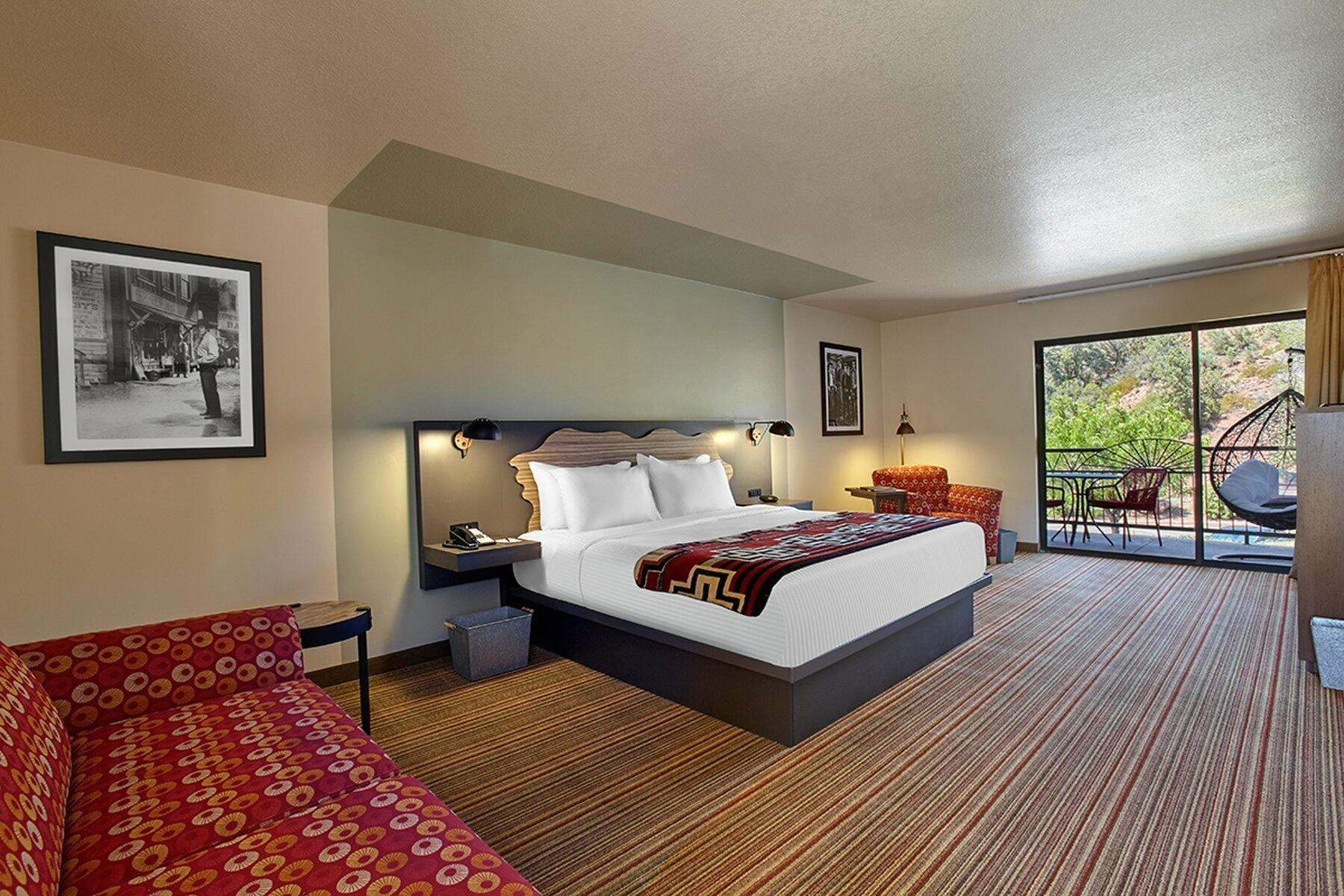 Hotel room with king bed and trailhead view.