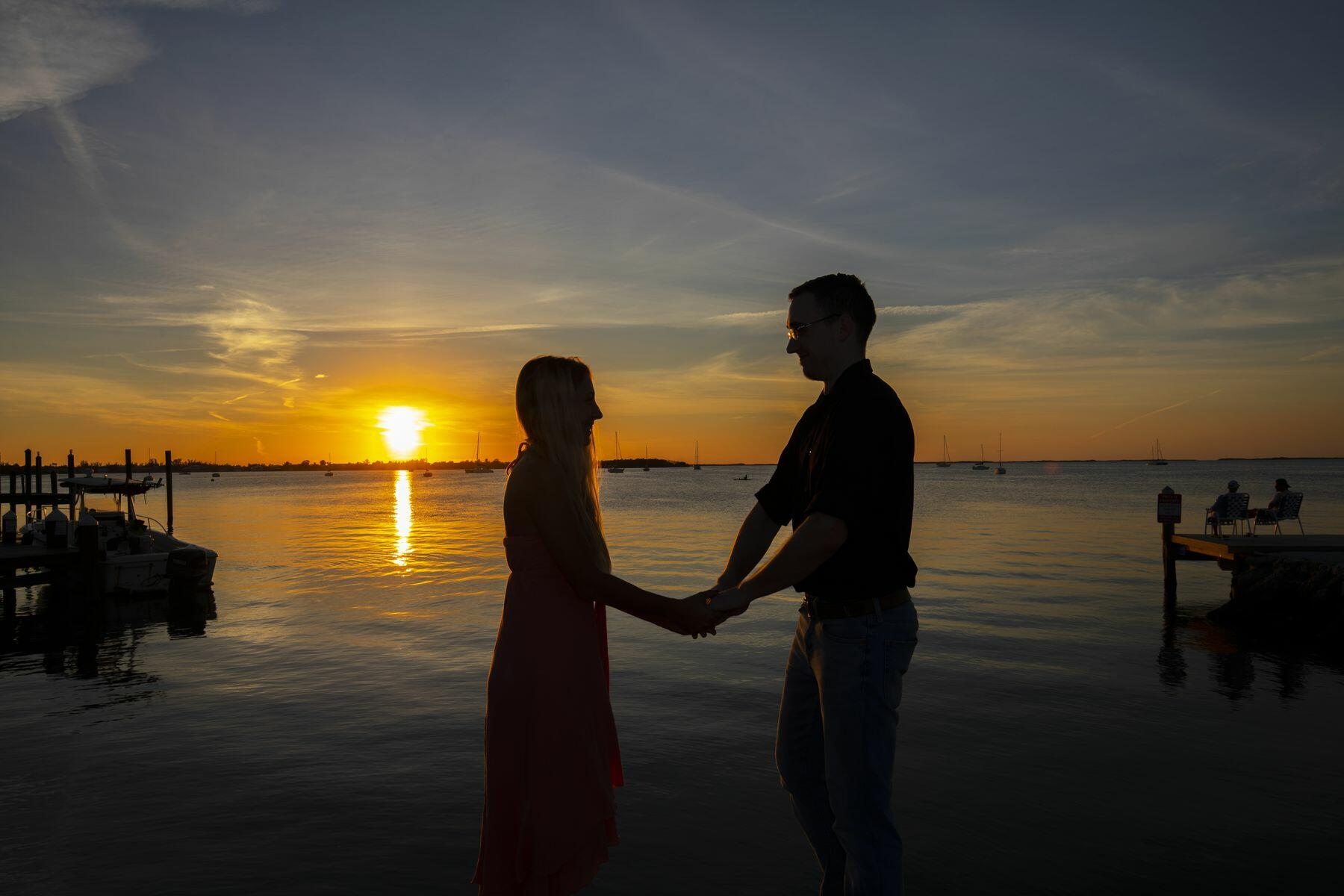 Couple by the sea during sunset