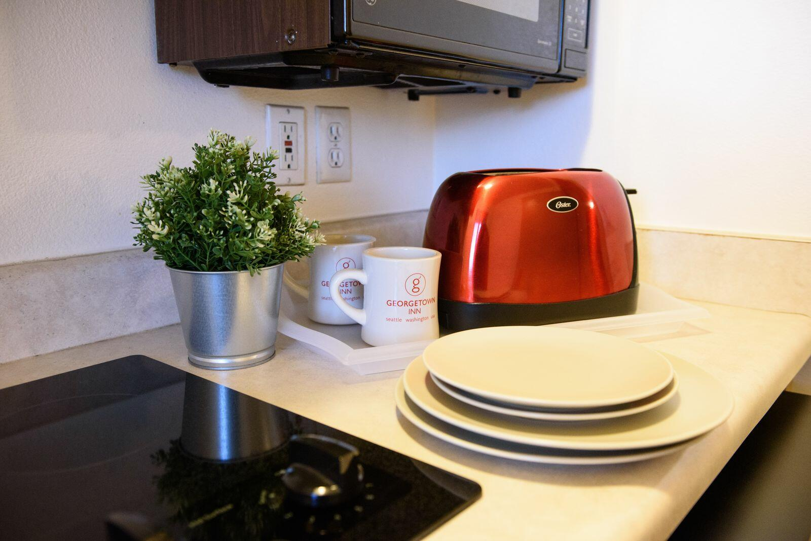 kitchenette with toaster and plates