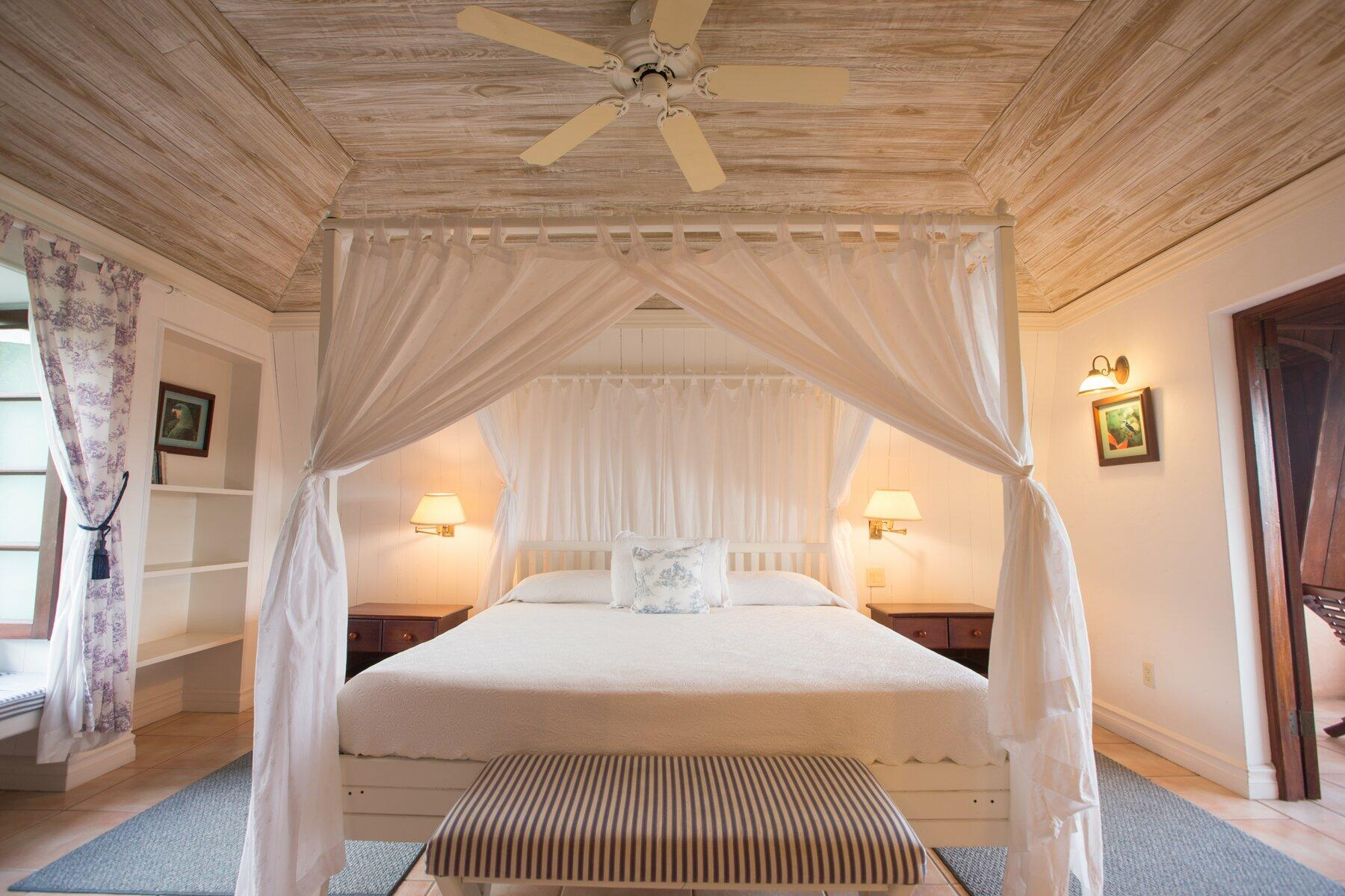 King-size canopy bed with ocean view