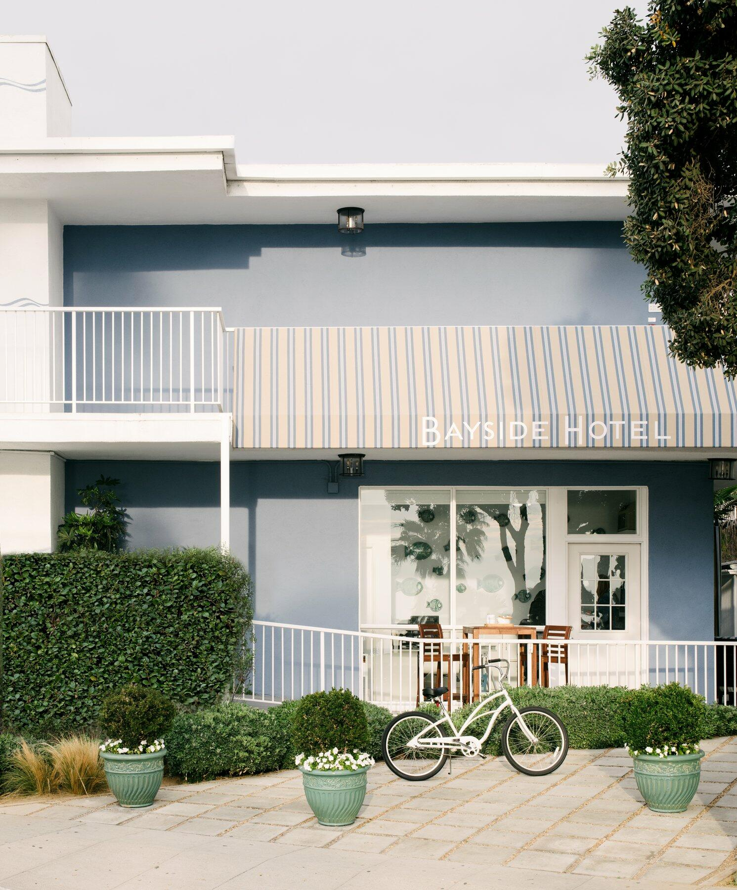 Hotel exterior with balcony and bicycle