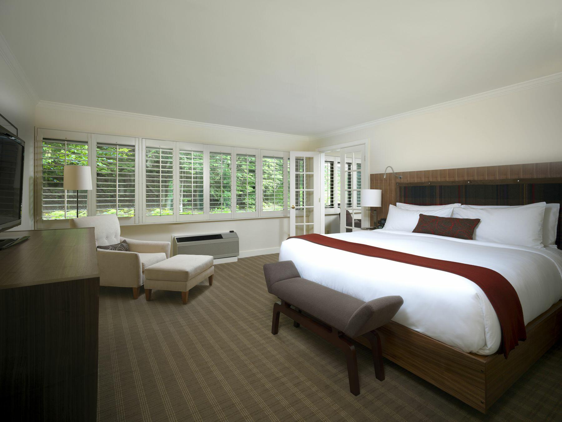 Large hotel room with king bed.