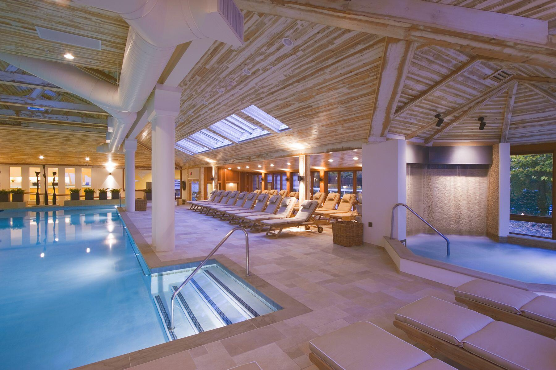 Indoor spa pool and waterfall.