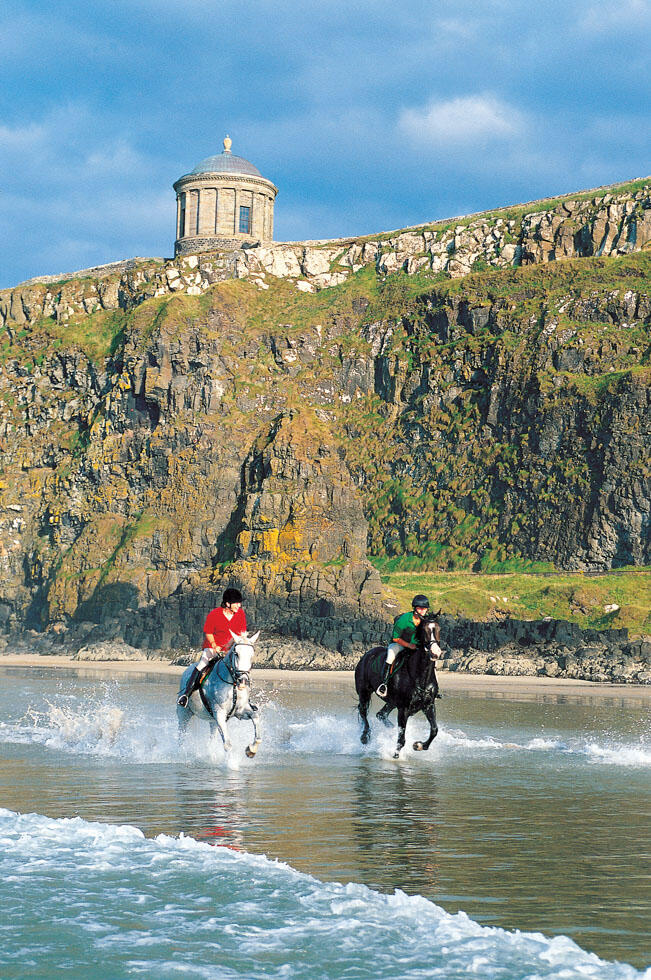 Horse Riders On The Beach Below Mussenden Temple