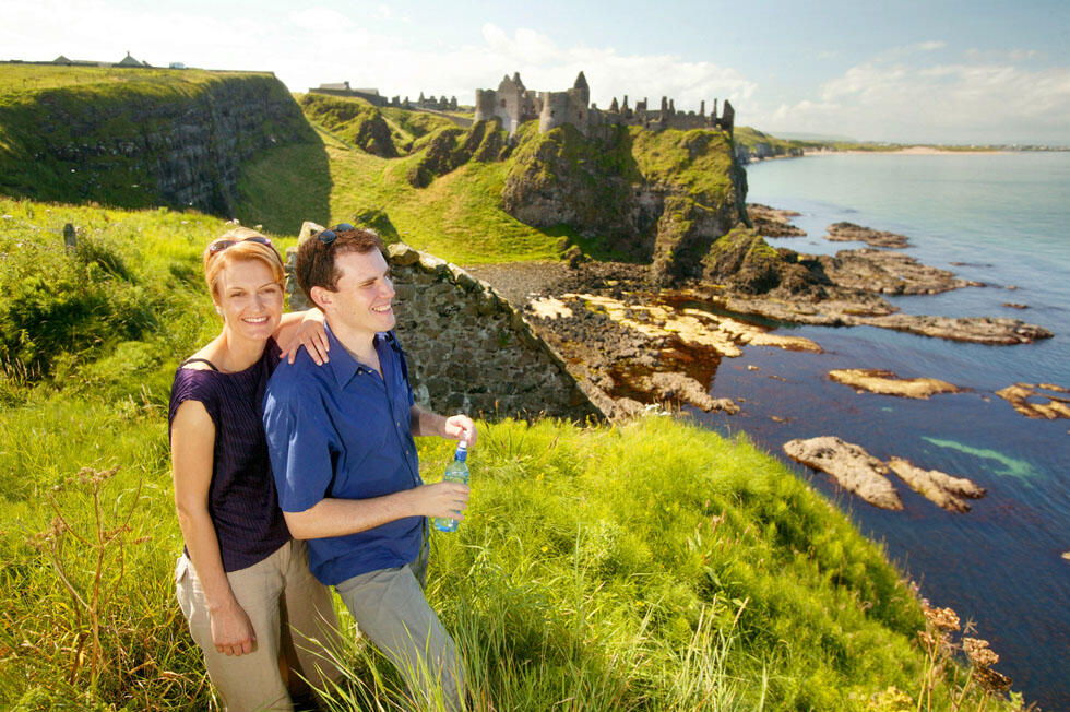 Couple On Cliffs By Dunluce Castle