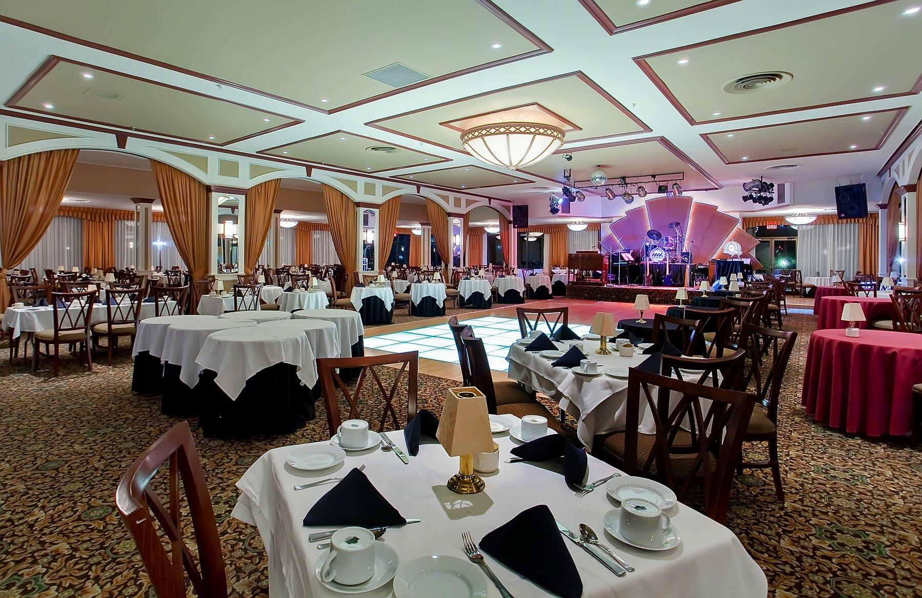 Event space set with tables and dance floor.