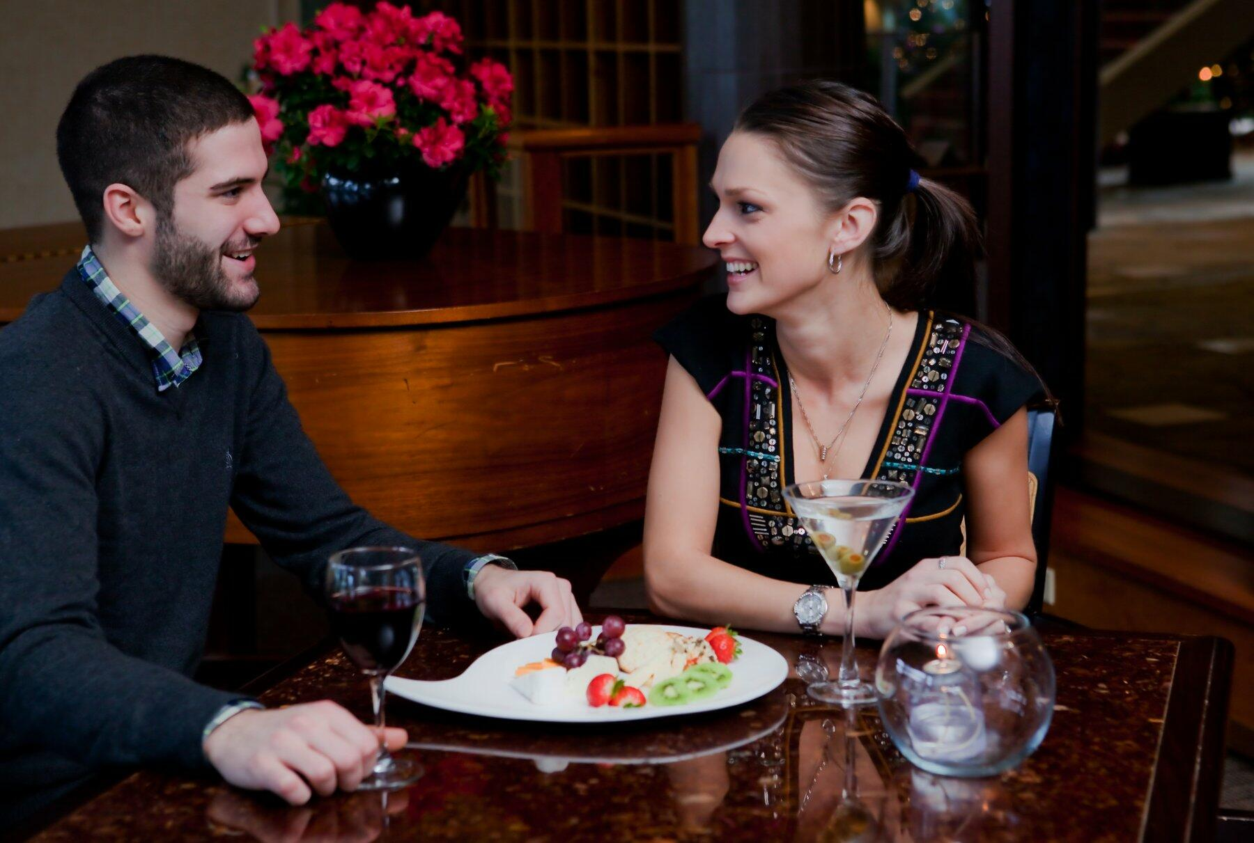 Couple enjoying appetizer and drinks.