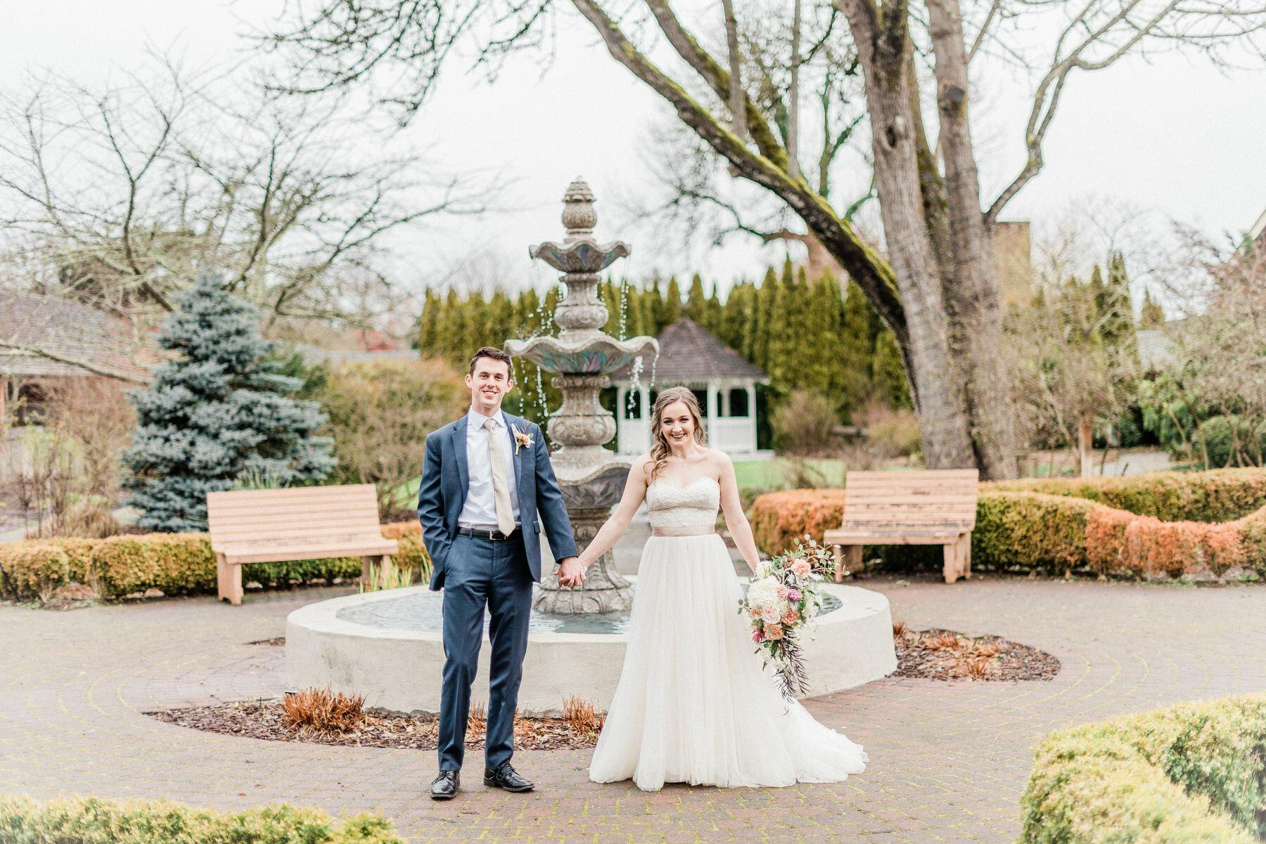 married couple in front of fountain
