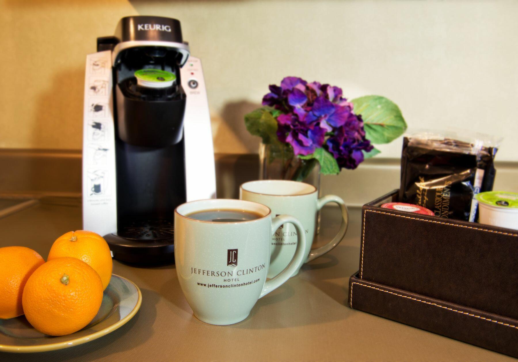 Keurig coffee maker, coffee cups and oranges