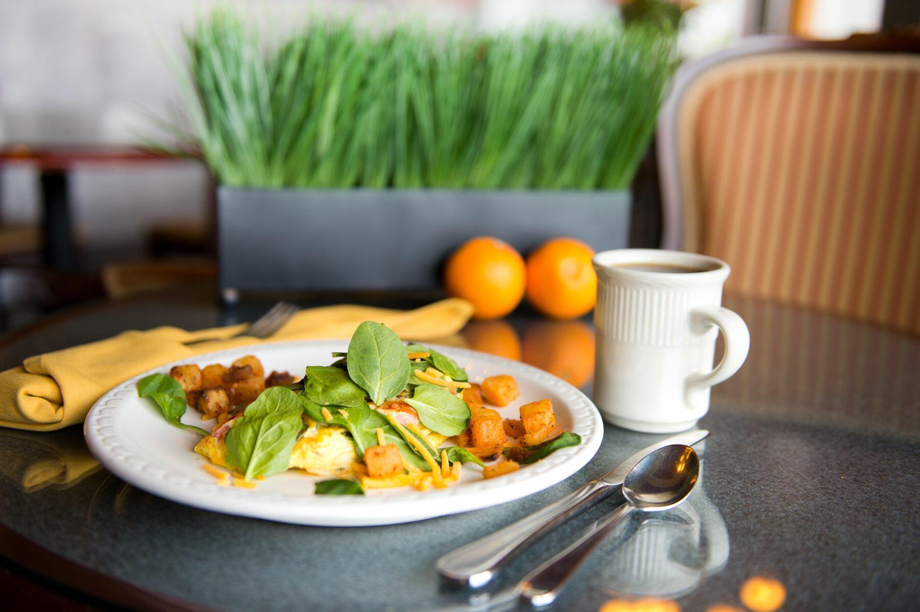 Plated breakfast with coffee mug