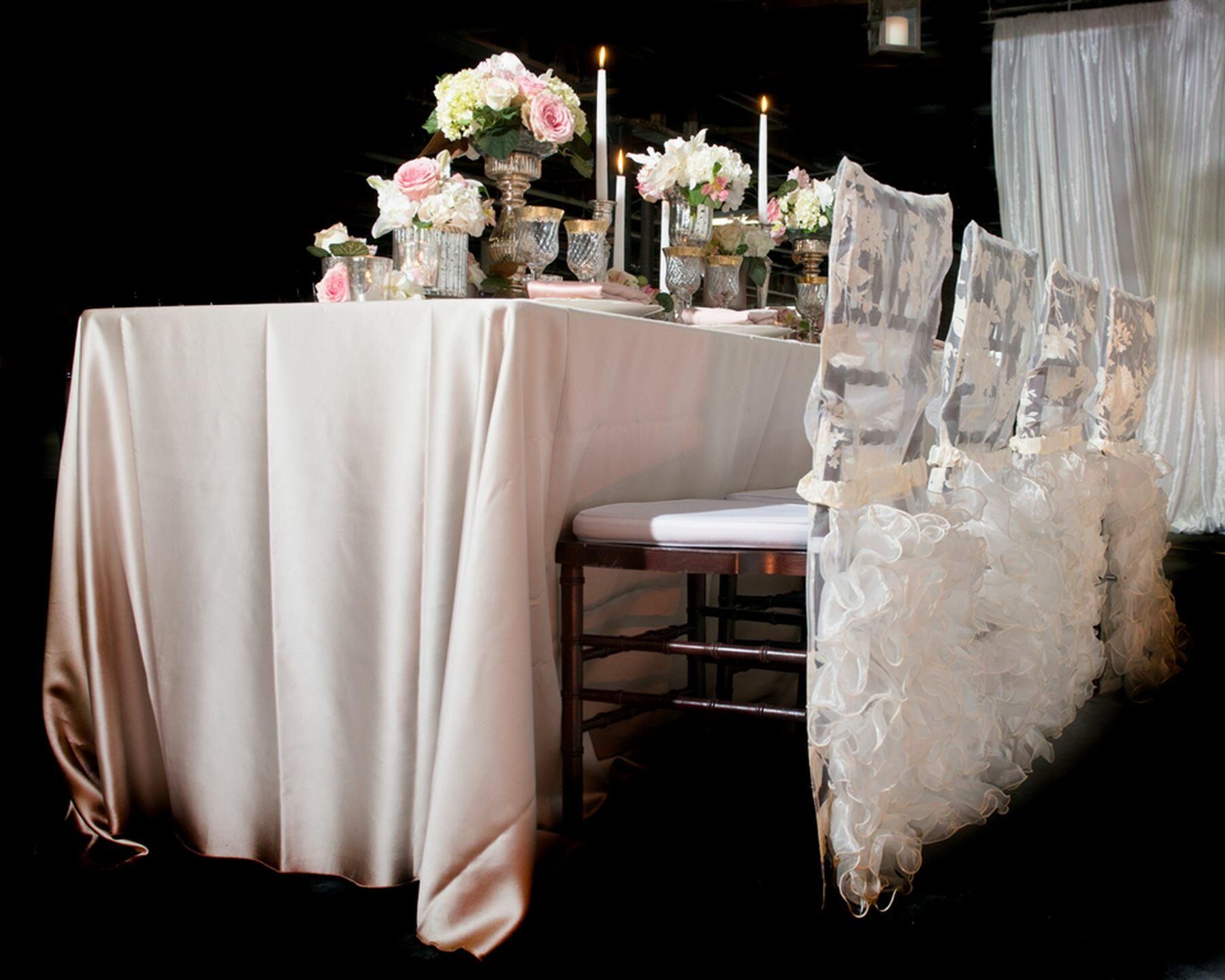 Wedding reception table with floral centerpiece.
