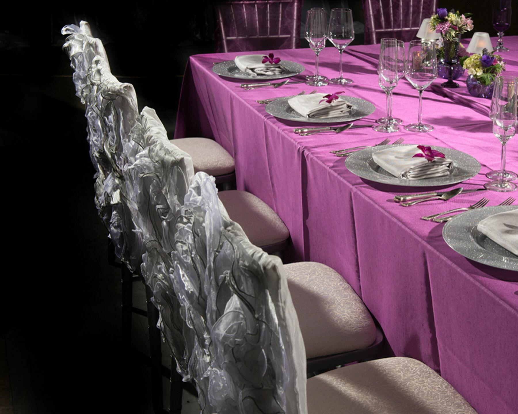 Wedding reception table with place settings and floral centerpie
