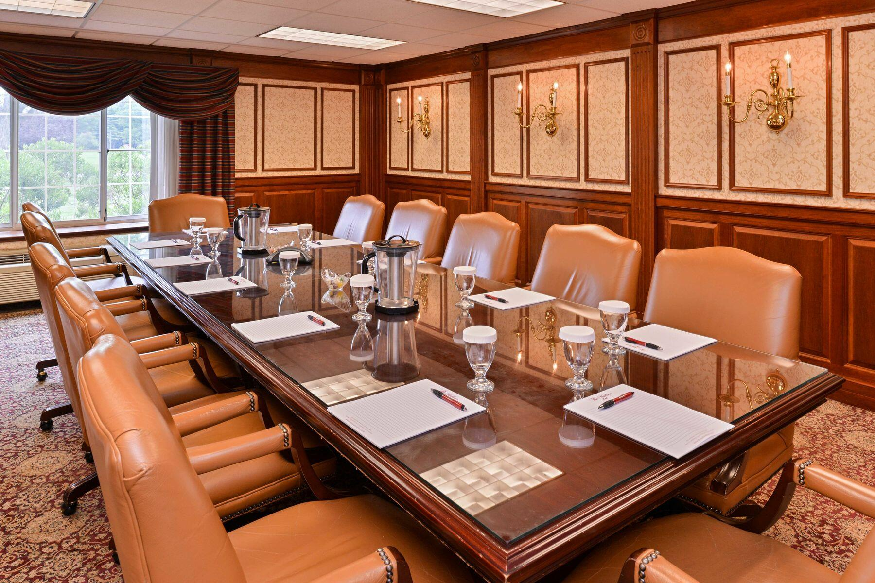 Board room with long table and executive chairs