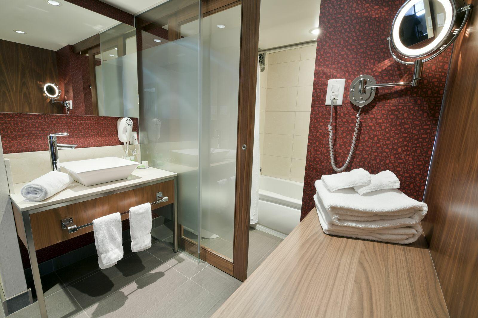 Guest bathroom vanity and tub.