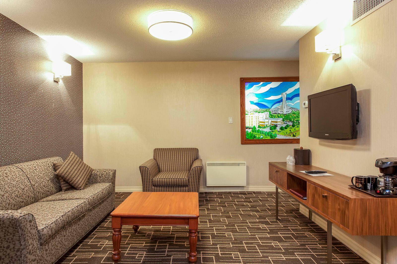 Suite living room with wall mounted TV.