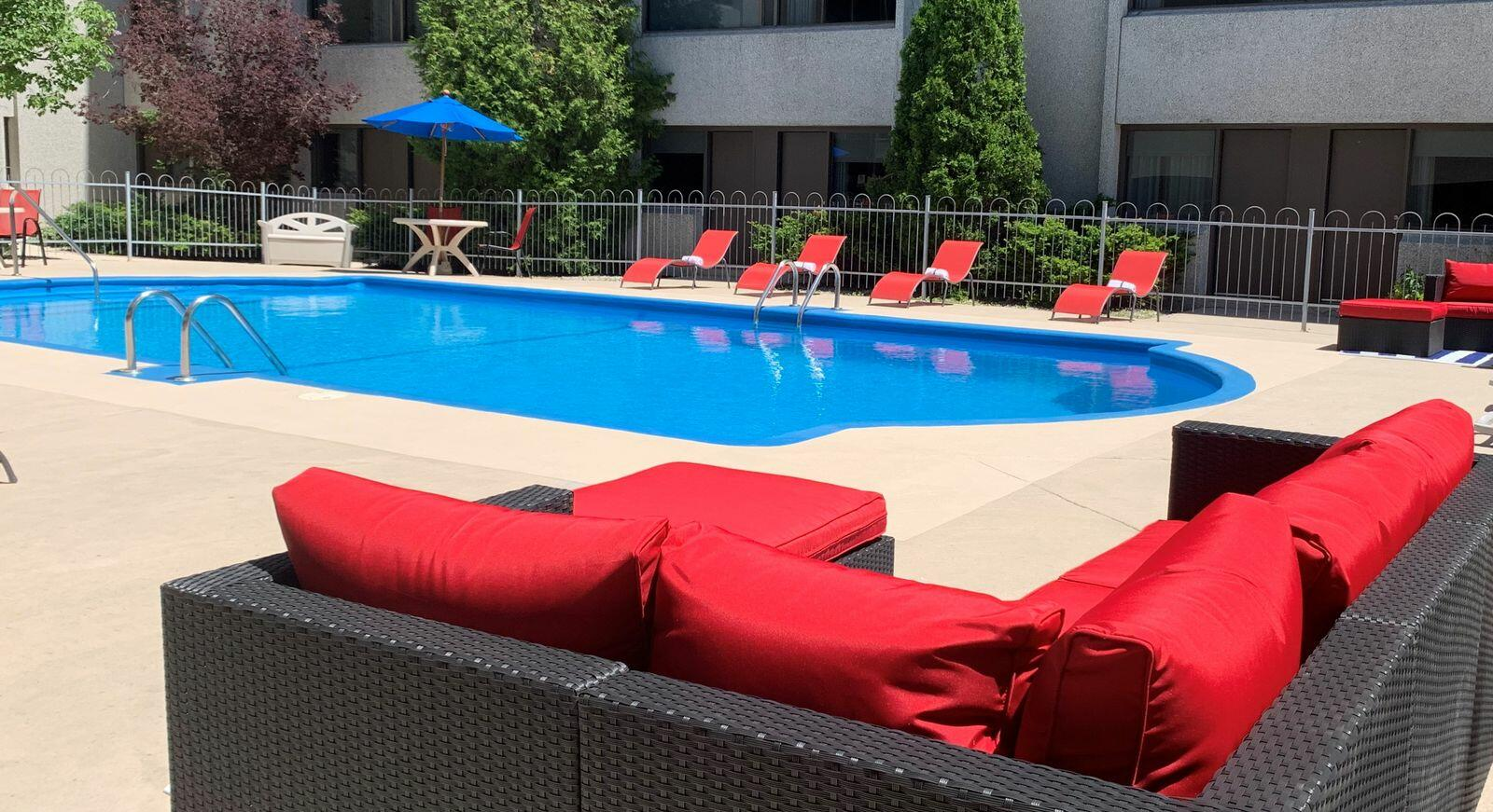 Patio seating by outdoor pool.