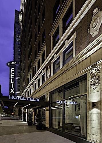hotel felix sign at night