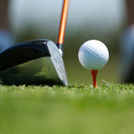 Close up of golf ball on tee and club