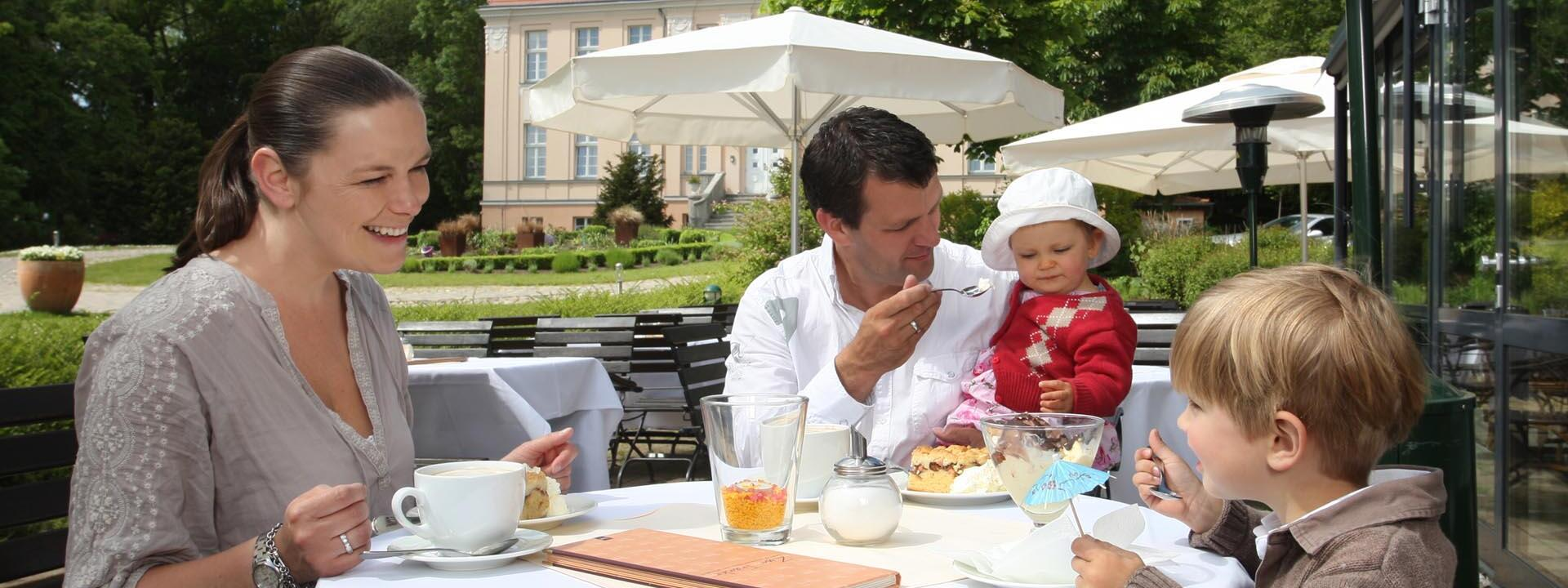 family at the terrace restaurant at Precise Resort Rügen