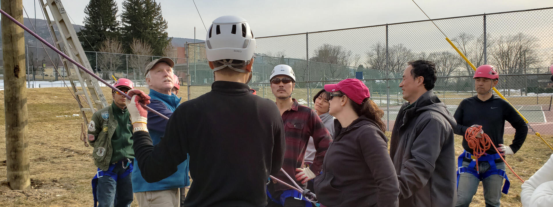 People in harnesses at ropes course