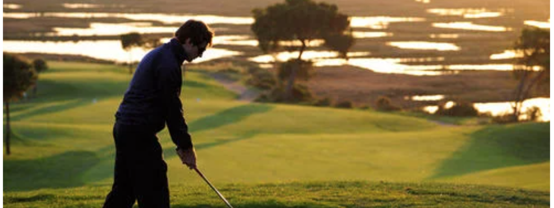 man playing golf at Precise Resort El Rompido