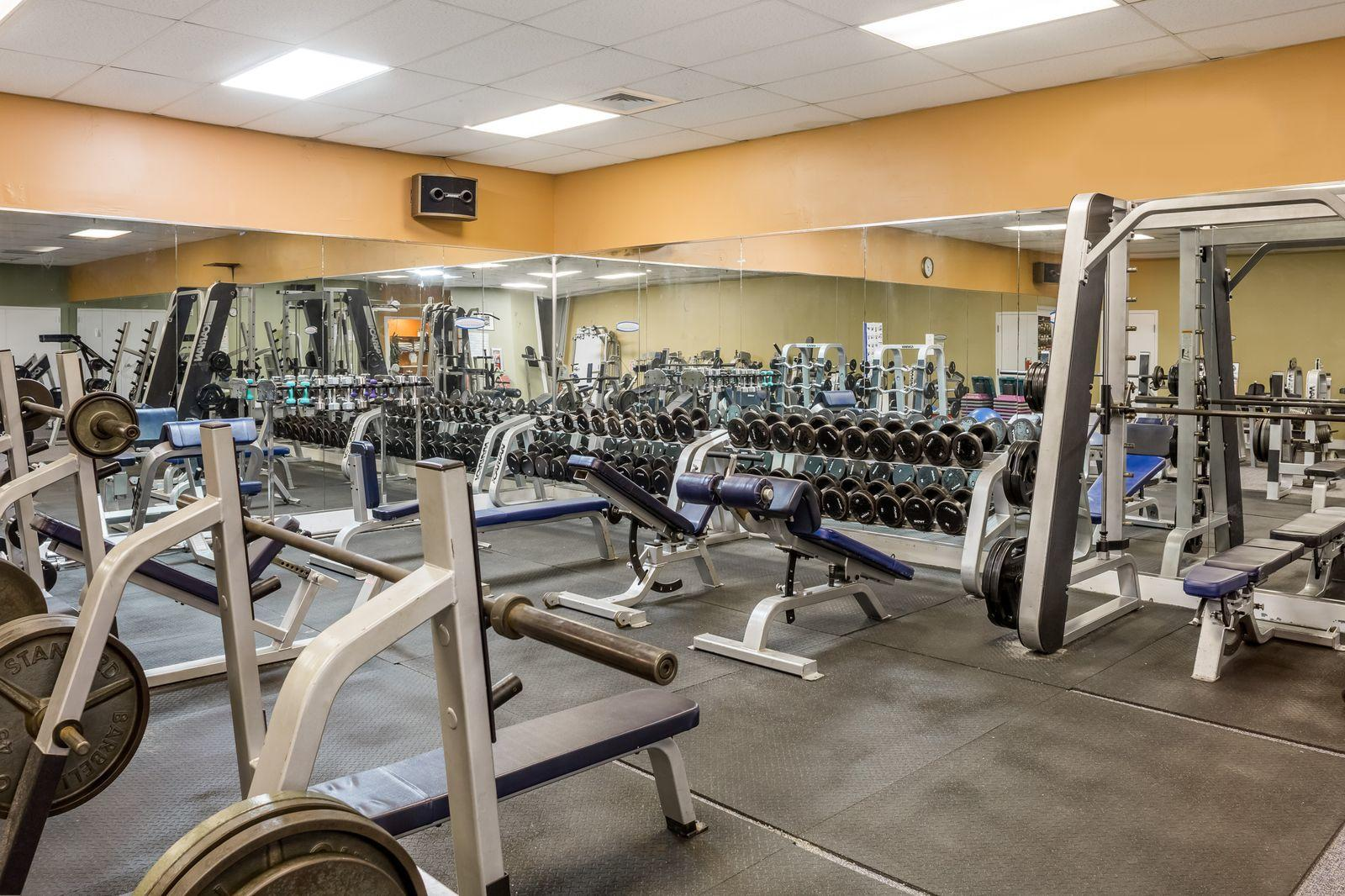 Fitness room with multiple workout stations.