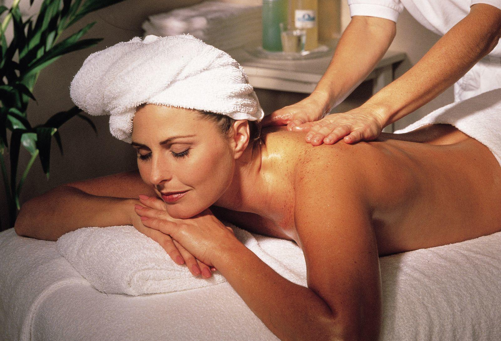 Woman receiving body massage.
