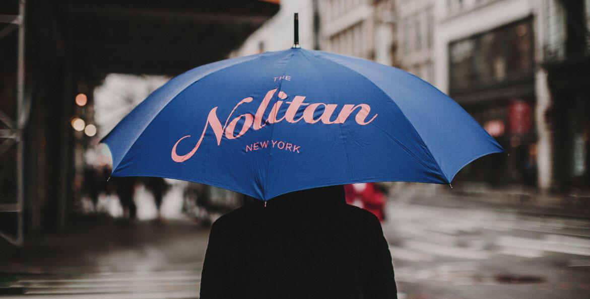 Guest with Nolitan New York umbrella