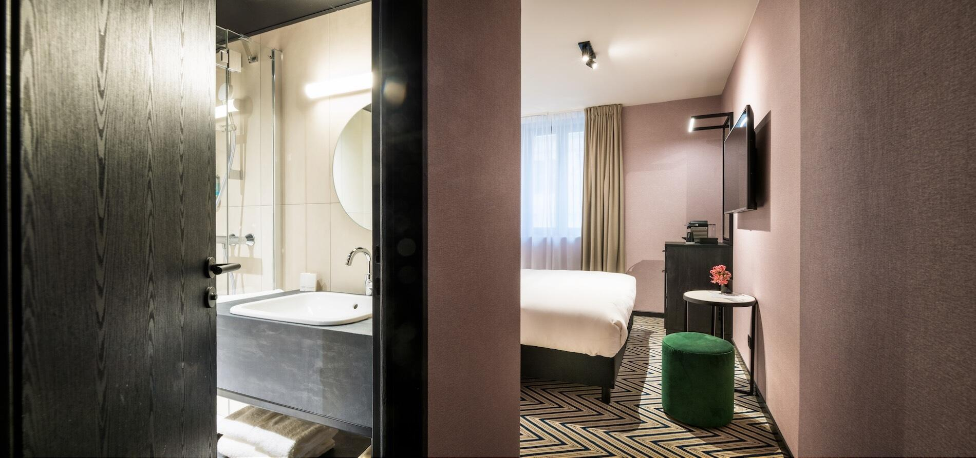 Bathroom and bedroom at Hotel Hubert Brussels
