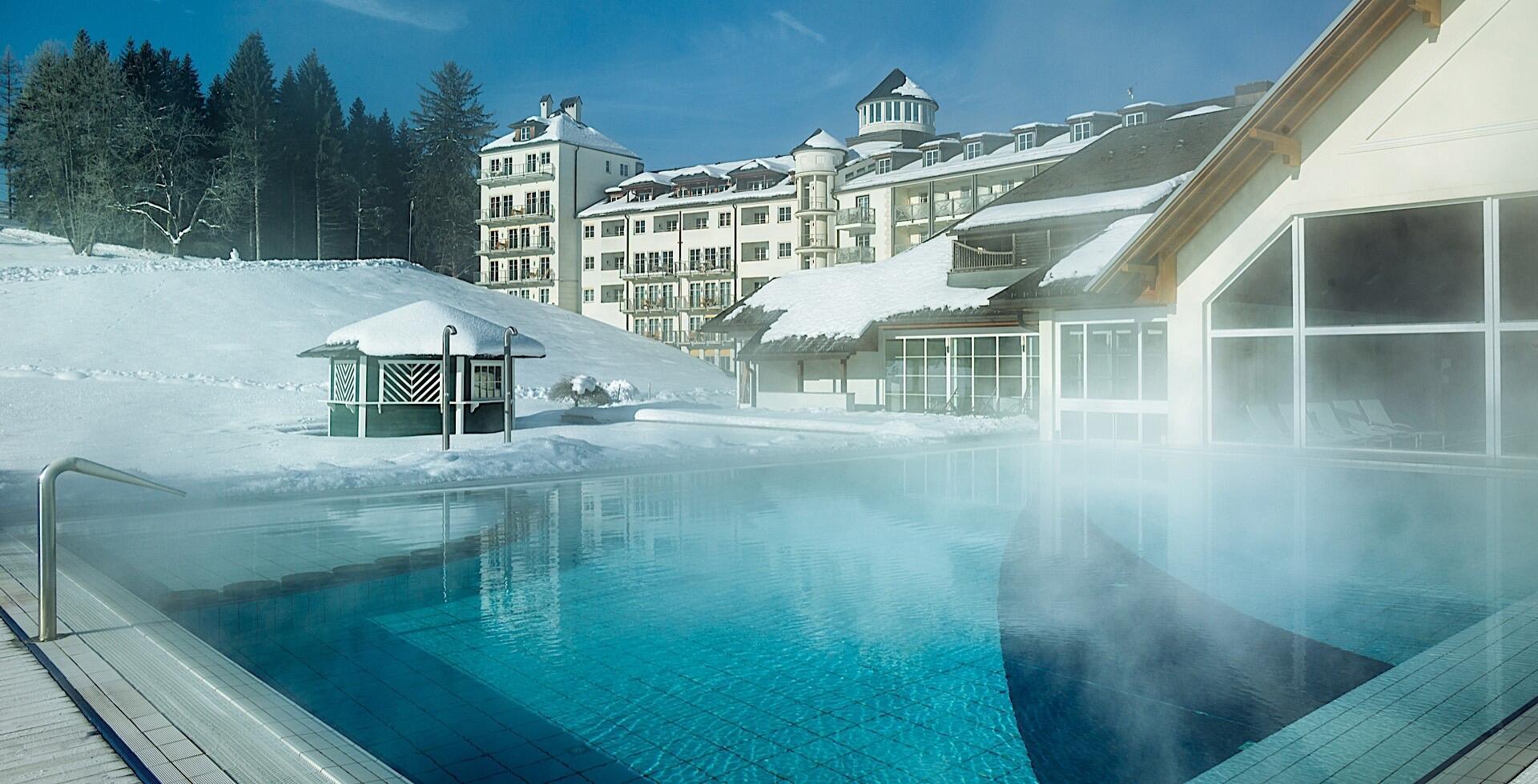 Outdoor Pool in Winter at Romantik Hotel Schloss Pichlarn
