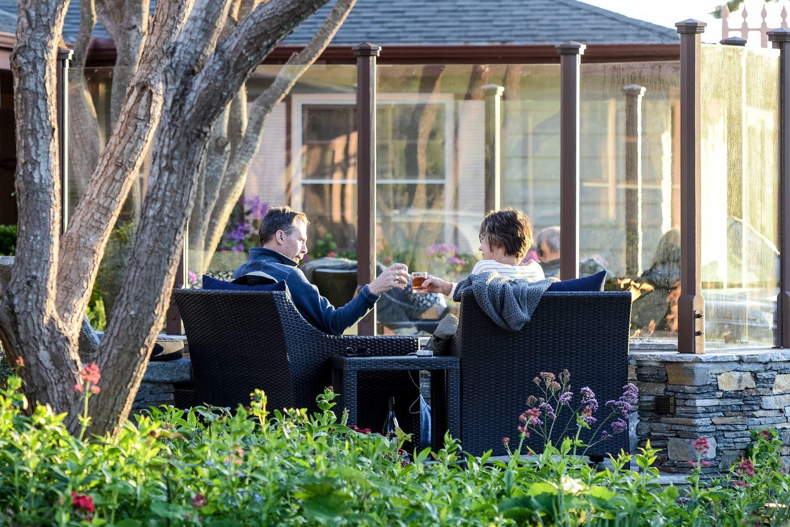 couple toasting at fire pit at sea otter inn