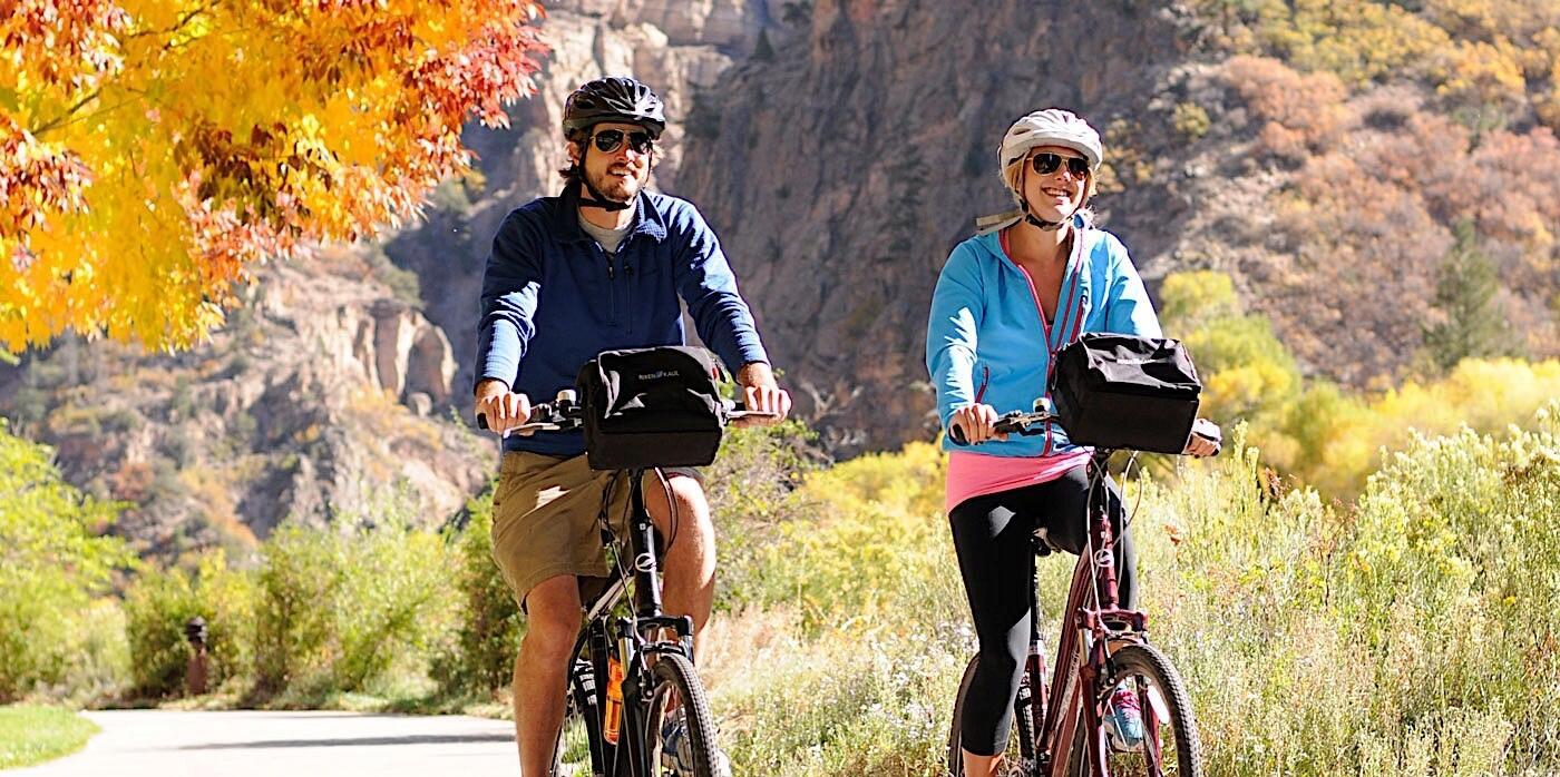 Man and woman biking in Glenwood Canyon
