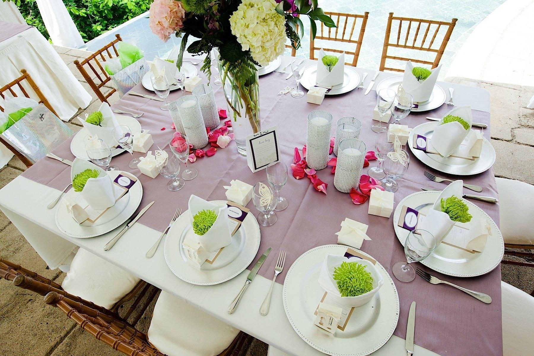 Large table set for wedding guests