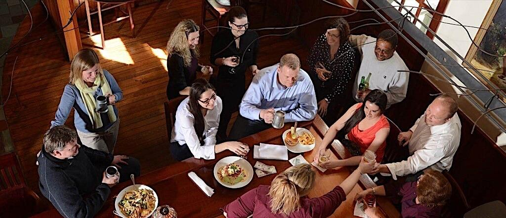 Group of guests eating at restaurant