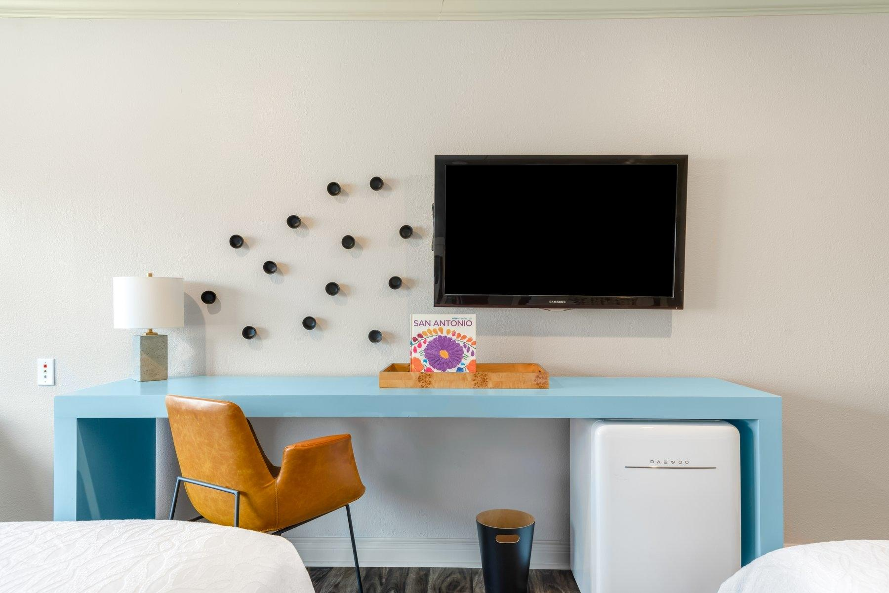 Desk and chair with TV mounted on wall