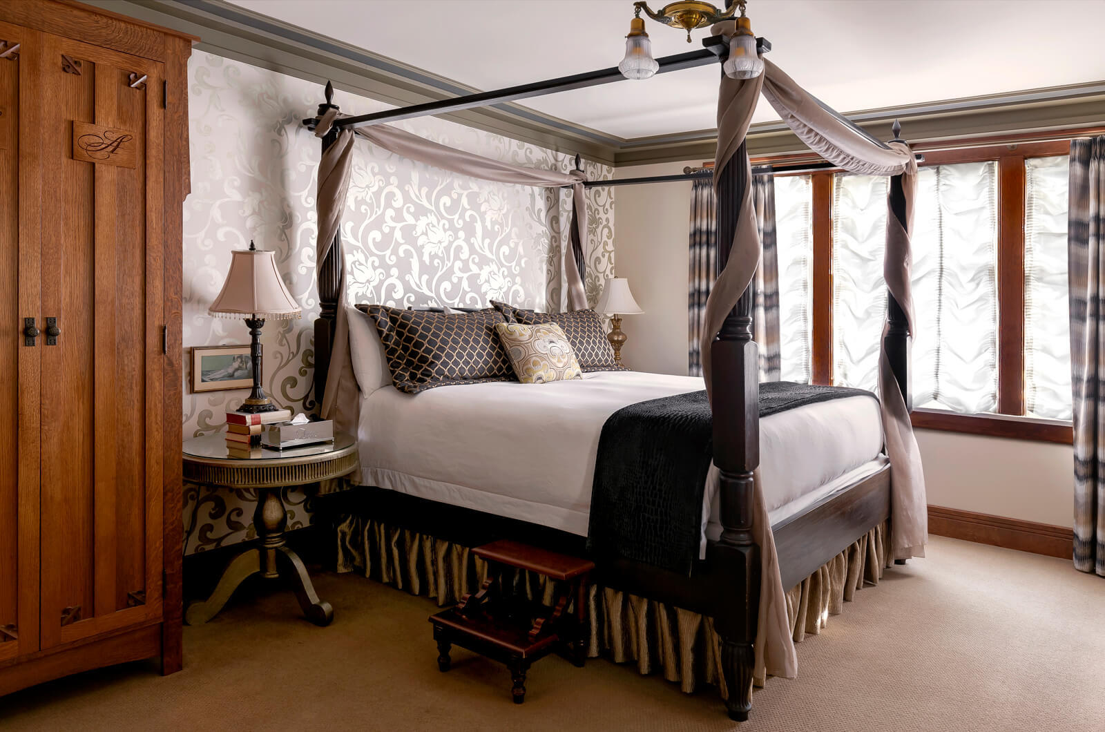 Four post bed with nightstand and amoire