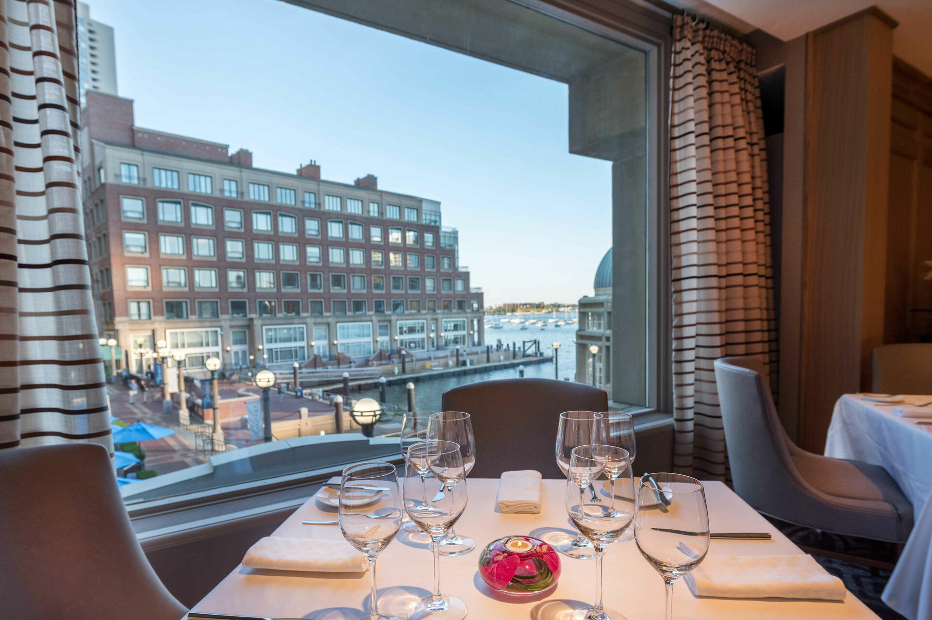 View of the Boston waterfront from inside Meritage The Restauran