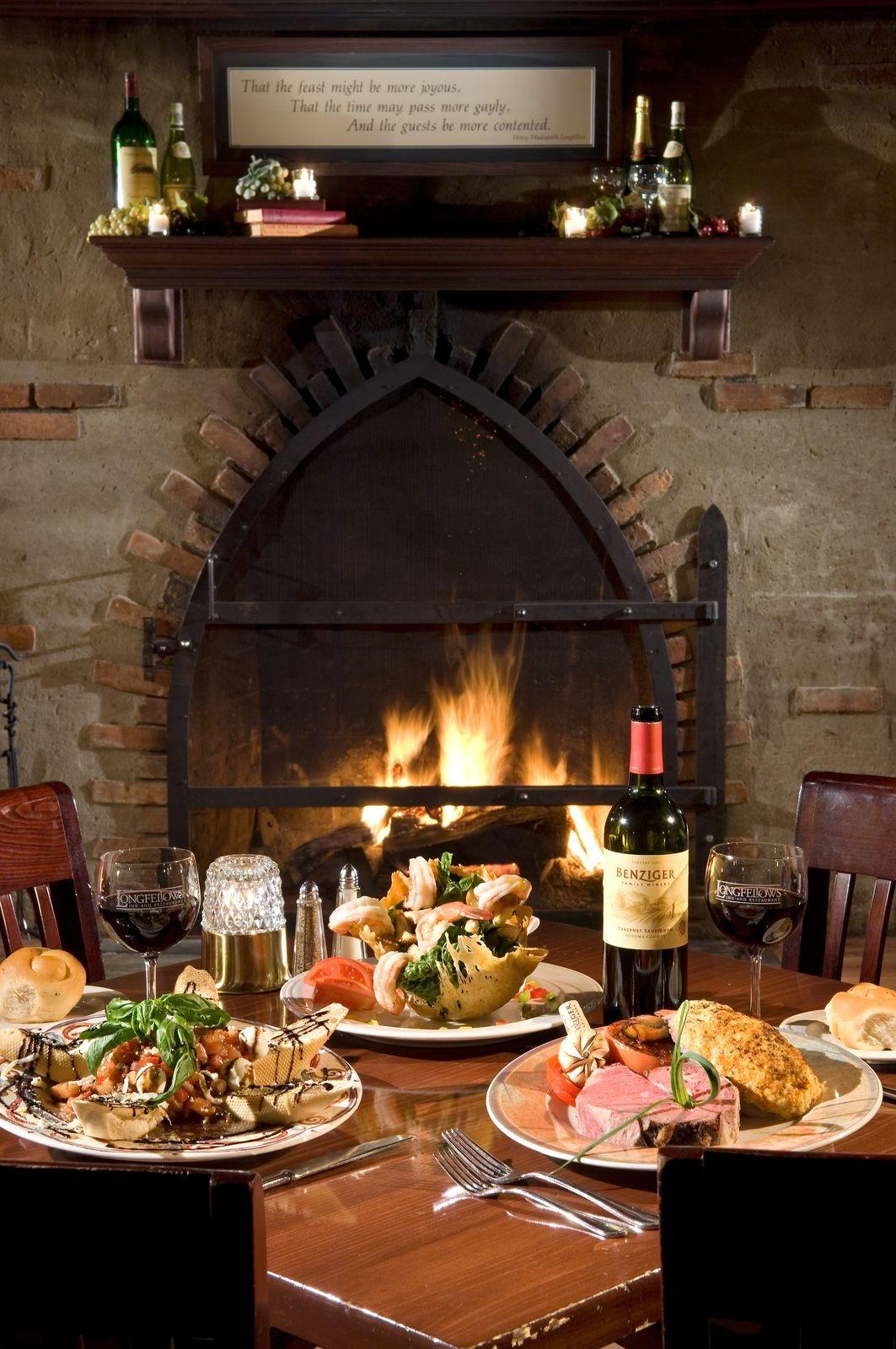 Extravagant dinner set at a table beside a fireplace