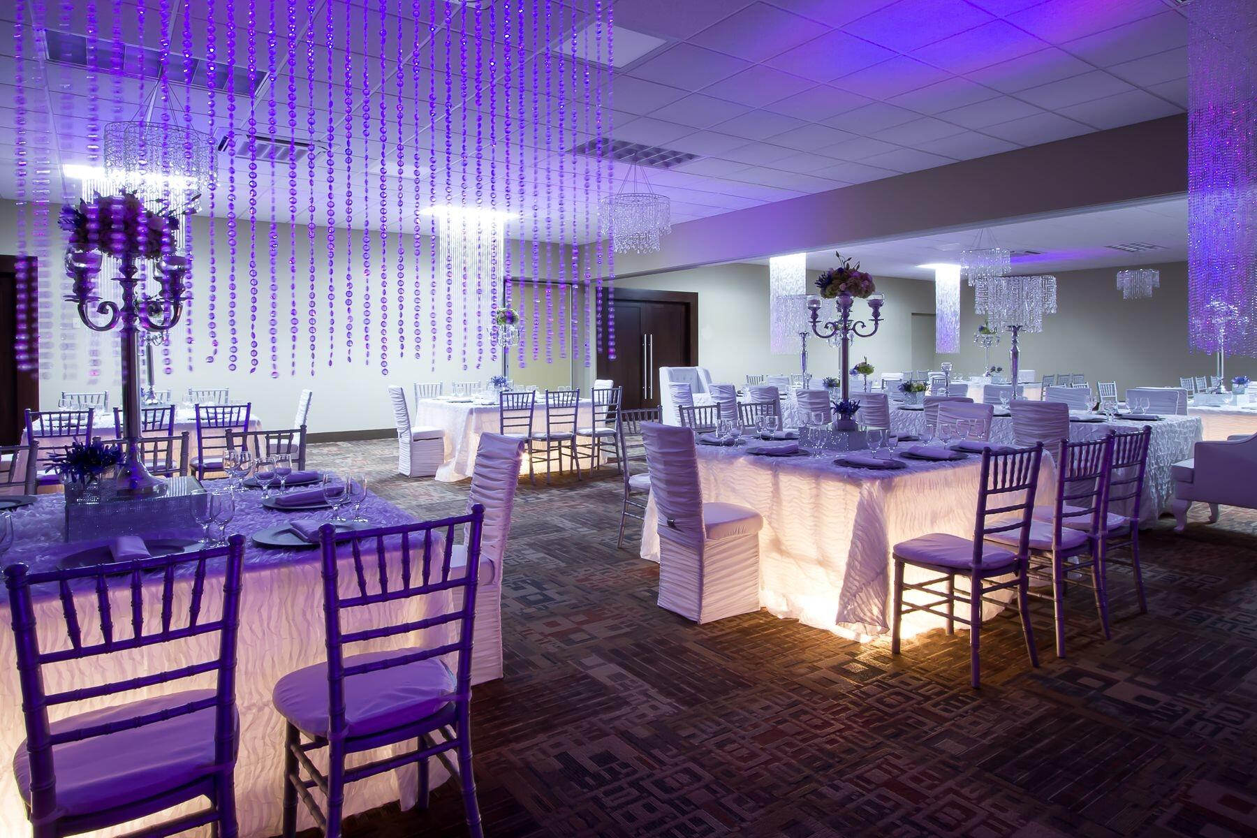 Wedding reception tables illuminated from lights under tables