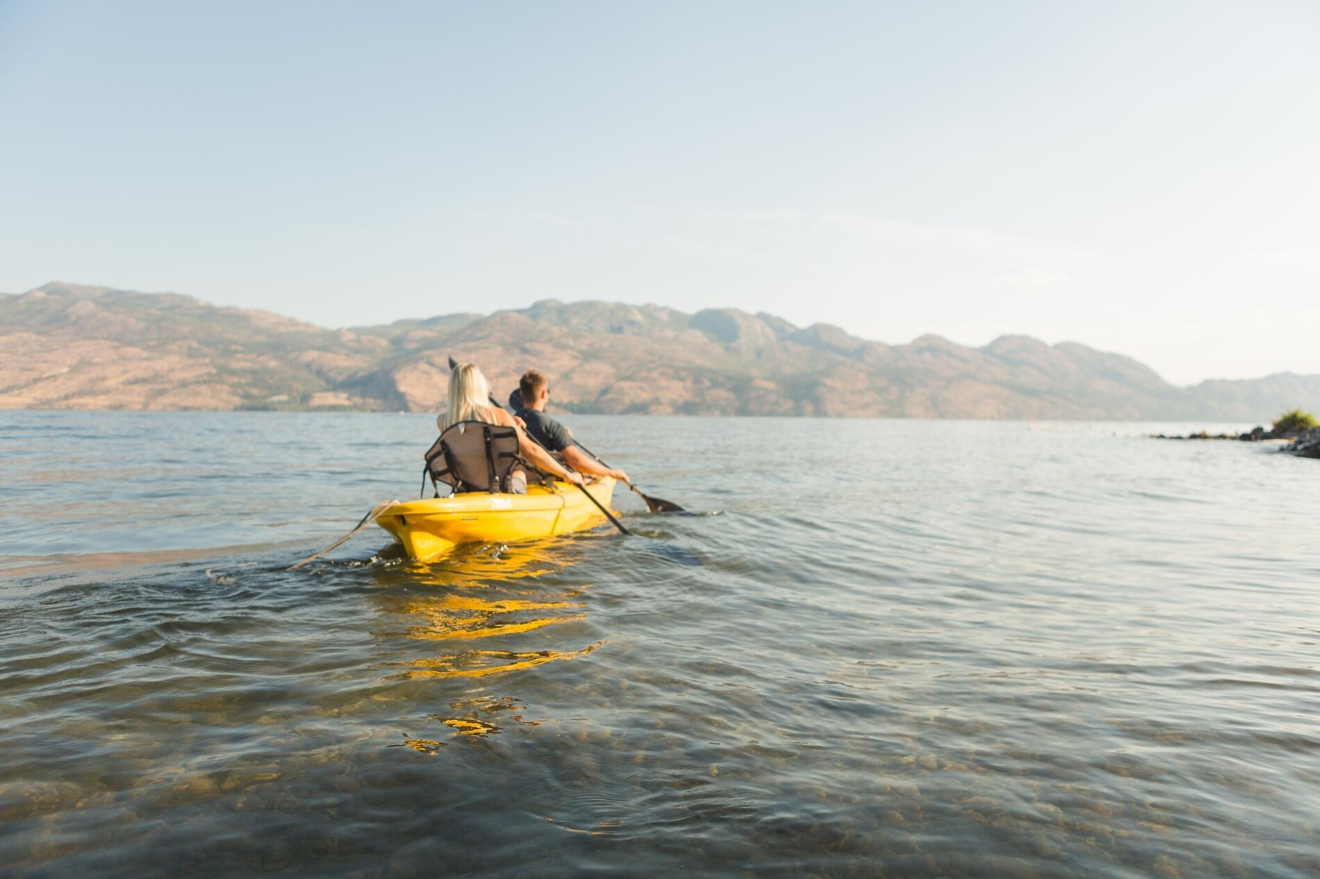 Guests kayaking on Lake Okanagan