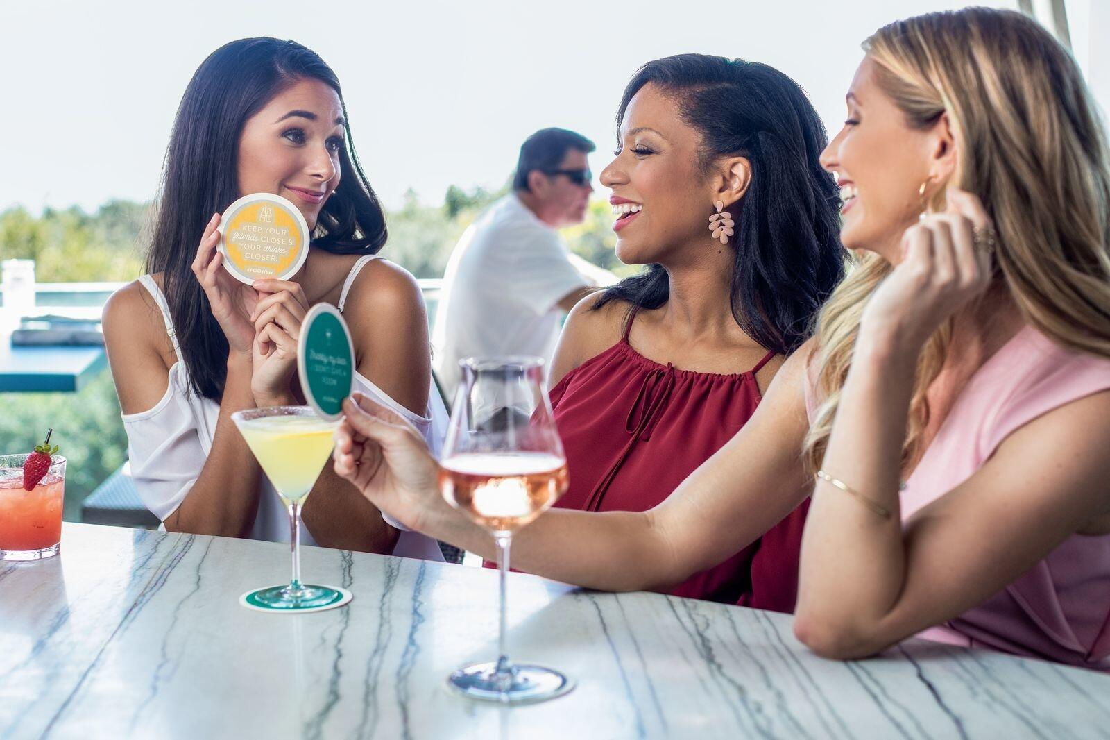 Girls with cocktails on the patio bar
