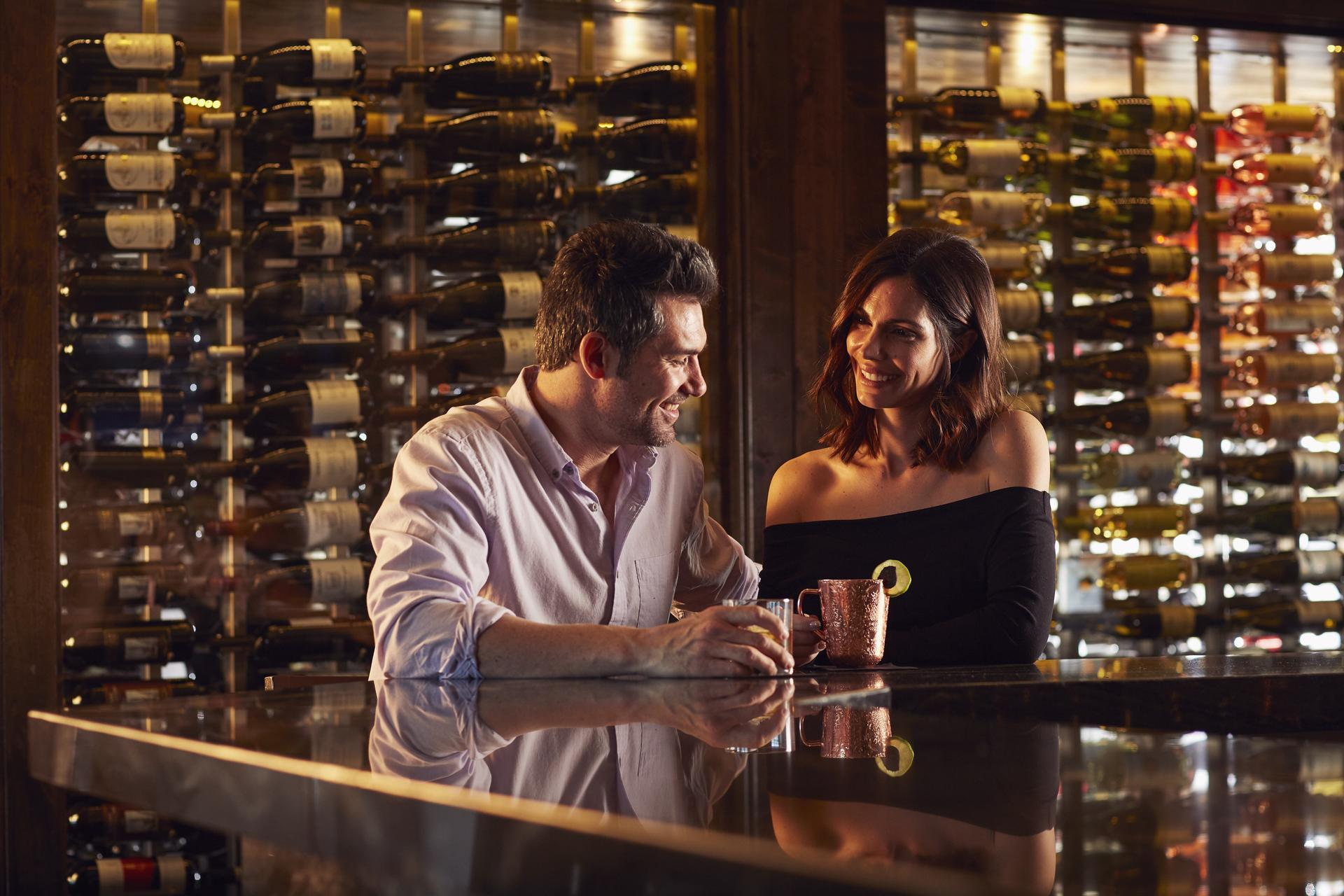Couple drinking at hotel bar